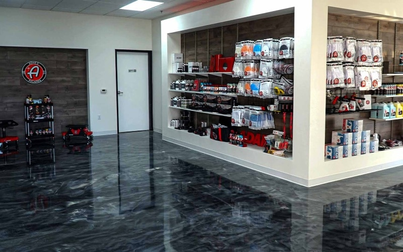 Retail store with silver epoxy floor displaying several random products